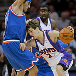 Phoenix Suns' Goran Dragic, (2), from Slovenia, tries to get past Cleveland Cavaliers' Anderson Varejao, left, of Brazil, in the fourth quarter in an NBA basketball game Wednesday, Dec. 2, 2 …