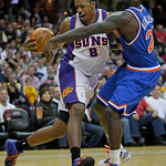 Phoenix Suns' Channing Frye (8) drives past Cleveland Cavaliers' J.J. Hickson (21) in the first quarter in an NBA basketball game Wednesday, Dec. 2, 2009, in Cleveland. The Cavaliers won 107 …
