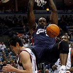 Cleveland Cavaliers' Shaquille O'Neal slam dunks in front of Milwaukee Bucks' Ersan Ilyasova during the first half of an NBA basketball game Sunday, Dec. 6, 2009, in Milwaukee. (AP Photo/Mor …