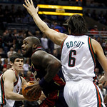Cleveland Cavaliers' Shaquille O'Neal tries to drive past Milwaukee Bucks' Andrew Bogut (6) and Ersan Ilyasova during the first half of an NBA basketball game Sunday, Dec. 6, 2009, in Milwau …