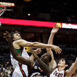 Milwaukee Bucks' Andrew Bogut and Ersan Ilyasova (7) battle for a rebound with Cleveland Cavaliers' J.J. Hickson (21) during the first half of an NBA basketball game Sunday, Dec. 6, 2009, in …