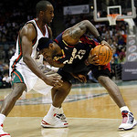 Cleveland Cavaliers' LeBron James (23) tries to drive on Milwaukee Bucks' Luc Richard Mbah a Moute (12) during the first half of an NBA basketball game Sunday, Dec. 6, 2009, in Milwaukee. (A …