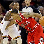 Chicago Bulls' Derrick Rose (1) drives past Cleveland Cavaliers' Mo Williams in the fourth quarter of an NBA basketball game Wednesday, Dec. 8, 2010, in Cleveland. The Bulls won 88-83. (AP P …