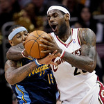 Cleveland Cavaliers forward LeBron James, right, tries to get past Denver Nuggets forward Carmelo Anthony in the first quarter in an NBA basketball game Thursday, Feb. 18, 2010, in Cleveland …