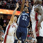 Memphis Grizzlies guard O.J. Mayo, center, shoots between Cleveland Cavaliers' Shaquille O'Neal, right, and Anthony Parker in the second quarter of an NBA basketball game Tuesday, Feb. 2, 20 …