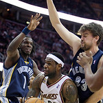 Cleveland Cavaliers' LeBron James (23) looks for help under pressure from Memphis Grizzlies forward DeMarre Carroll (1) and Marc Gasol, from Spain, in the fourth quarter of an NBA basketball …