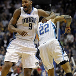 Orlando Magic forward Rashard Lewis, left, celebrates with teammate Matt Barnes after hitting a three-point basket late in the second half of an NBA basketball game against the Cleveland Cav …