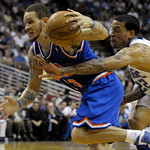 Cleveland Cavaliers guard Delonte West, left, drives past Orlando Magic forward Matt Barnes during the first half of an NBA basketball game in Orlando, Fla., Sunday, Feb. 21, 2010. (AP Photo …
