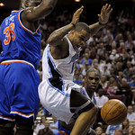 Orlando Magic guard Jameer Nelson, center, loses control of the ball while going up for a shot between Cleveland Cavaliers center Shaquille O'Neal, left, and Antawn Jamison during the first …