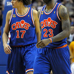 Cleveland Cavaliers forward LeBron James, right, reacts to a play as he and teammate Anderson Varejao, of Brazil, walk off the court during a time-out in the second half of an NBA basketball …