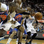 Orlando Magic center Dwight Howard, center, steals the ball from Cleveland Cavaliers forward Antawn Jamison, left, as Magic's Mickael Pietrus (20), of France, watches during the first half o …
