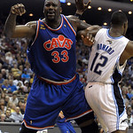 Cleveland Cavaliers center Shaquille O'Neal, left, complains to the referee while being defended by Orlando Magic center Dwight Howard during the first half of an NBA basketball game in Orla …