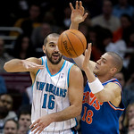 New Orleans Hornets forward Peja Stojakovic (16), from Serbia, passes the ball past Cleveland Cavaliers guard Anthony Parker (18) in the first quarter of an NBA basketball game Tuesday, Feb. …