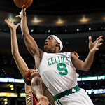Boston Celtics' Rajon Rondo (9) goes up to shoot against Cleveland Cavaliers' Delonte West, left, in the first quarter of an NBA basketball game, Thursday, Feb. 25, 2010, in Boston. (AP Phot …