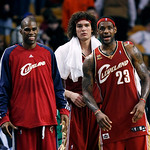 Cleveland Cavaliers players, from left, Antawn Jamison, Anderson Varejao, of Brazil, and LeBron Jamesin watch from the bench late in the fourth quarter of an NBA basketball game against the  …