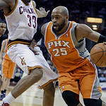 Phoenix Suns&#039; Vince Carter (25) drives past Cleveland Cavaliers&#039; Alonzo Gee (33) in the second quarter in an NBA basketball game Wednesday, Jan. 19, 2011, in Cleveland. (AP Photo/Tony Dejak)