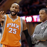 Phoenix Suns head coach Alvin Gentry, right, talks with Phoenix Suns' Vince Carter in the first quarter in an NBA basketball game against the Cleveland Cavaliers Wednesday, Jan. 19, 2011, in …