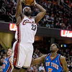 Cleveland Cavaliers forward LeBron James (23) jumps to the basket as New York Knicks guard Bill Walker (5) watches in the first quarter in an NBA basketball game Monday, March 1, 2010, in Cl …