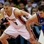 Cleveland Cavaliers guard Anthony Parker, left, and New York Knicks forward Danilo Gallinari, from Italy, battle for a loose ball in the third quarter in an NBA basketball game Monday, March …