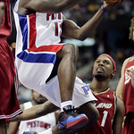 Detroit Pistons guard Will Bynum, left, goes to the basket past Cleveland Cavaliers guard Daniel Gibson (1) in the first half of an NBA basketball game Tuesday, March 16, 2010, in Auburn Hil …