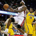 Cleveland Cavaliers' LeBron James slips inside Indiana Pacers' Solomon Jones (44) for a shot in the first quarter of an NBA basketball game Wednesday, March 17, 2010, in Cleveland. (AP Photo …