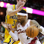 Cleveland Cavaliers' Mo Williams (2) runs into Indiana Pacers' Troy Murphy in the second quarter of an NBA basketball game Wednesday, March 17, 2010, in Cleveland. (AP Photo/Mark Duncan)