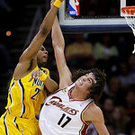 Indiana Pacers' Brandon Rush, left, is fouled by Cleveland Cavaliers' Anderson Varejao (17), from Brazil, in the fourth quarter of an NBA basketball game Wednesday, March 17, 2010, in Clevel …