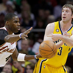 Indiana Pacers' Troy Murphy (3) passes around Cleveland Cavaliers' Antawn Jamison in the first quarter of an NBA basketball game Wednesday, March 17, 2010, in Cleveland. (AP Photo/Mark Dunca …