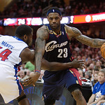 Cleveland Cavaliers' LeBron James (23) fights is way around Detroit Pistons' Jason Maxiell (54) in the third quarter of an NBA basketball game Sunday, March 21, 2010, in Cleveland. James sco …