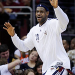 Cleveland Cavaliers' LeBron James jokes around on the bench in the fourth quarter of an NBA basketball game against the Detroit Pistons on Sunday, March 21, 2010, in Cleveland. James scored  …