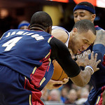 Detroit Pistons' Tayshaun Prince, center, tries to fight past Cleveland Cavaliers' Antawn Jamison (4) and Mo Williams in the third quarter of an NBA basketball game Sunday, March 21, 2010, i …