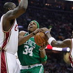 Boston Celtics' Paul Pierce (34) tries to drive between Cleveland Cavaliers' Shaquille O'Neal, left, and Antawn Jamison in the first quarter of Game 5 of a second round NBA basketball playof …