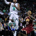 Boston Celtics guard Rajon Rondo, left, drives past Cleveland Cavaliers forward LeBron James, right, during the first half of Game 4 in a second-round NBA basketball playoff series Sunday, M …