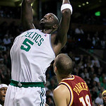 Boston Celtics forward Kevin Garnett (5) goes up for a dunk over Cleveland Cavaliers forward Anthony Parker during the first half of Game 4 in a second-round NBA basketball playoff series, S …