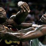 Boston Celtics center Kendrick Perkins, right, and Cleveland Cavaliers center Shaquille O'Neal, left, push off each other on a rebound during the first half of Game 4 in a second-round NBA b …