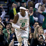 Fans cheers as Boston Celtics guard Rajon Rondo (9) runs back upcourt after scoring against the Cleveland Cavaliers during Game 4 in a second-round NBA basketball playoff series in Boston on …