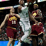 Boston Celtics guard Rajon Rondo (9) drives past Cleveland Cavaliers' Anthony Parker (18) and LeBron James, right, in the second half of Game 4 in a second-round NBA basketball playoff serie …