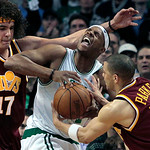 Boston Celtics forward Paul Pierce reacts as he fights for possession of the ball with Cleveland Cavaliers guard Anthony Parker (18) and forward Anderson Varejao (17) during the second half  …