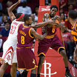 Cleveland Cavaliers guard Manny Harris (6) grabs a rebound in the second half of an NBA exhibition basketball game Sunday, Oct. 10, 2010, in Houston. Also reaching for the rebound are Housto …
