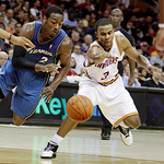 Washington Wizards point guard John Wall (2) and Cleveland Cavaliers point guard Ramon Sessions race for a loose ball in the second quarter of an NBA preseason basketball game Thursday, Oct. …