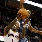 Charlotte Bobcats point guard Javaris Crittenton knocks the ball loose from Cleveland Cavaliers' Daniel Gibson (1) in the second quarter in an NBA preseason basketball game Tuesday, Oct. 5,  …