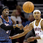 Charlotte Bobcats' Gerald Wallace, left, passes the ball past Cleveland Cavaliers' Jamario Moon in the fourth quarter during a NBA preseason basketball game Tuesday, Oct. 5, 2010, in Clevela …