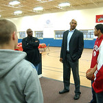 Clark Kellogg talks with members of EHS basketball team at a fundraiser at the Boys and Girls Club of Elyria Oct. 15.   from left, Brett Larrick, coach, Anthony Horton, Clark Kellogg, John C …