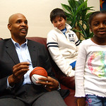 Clark Kellogg, left, former NBA and Ohio State player, signs a ball for Wes Gerhardt, 12, of Lakewood, and McKenzie Wright, 6, of Lorain, at the Boys and GIrls Club in Elyria Oct. 15.   Stev …