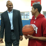 Clark Kellogg, former NBA and Ohio State player, signs a basketball for EHS player Anthony Horton at a benefit for the Boys and Girls Club of Elyria Oct. 15.   Steve Manheim/CT