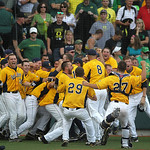 Oregon fans watch with disappointment as Kent State players celebrate a 3-2 victory in the bottom of the ninth inning during the final game of their NCAA college baseball tournament super re …