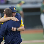 Kent State head coach Scott Stricklin get a hug after Kent State beat Oregon 3-2 in the deciding game of the NCAA Super Regional. (AP Photo/The Oregonian, Ross William Hamilton)
