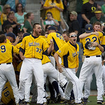 Kent State players celebrates their 3-2 win in the deciding game of an NCAA college baseball tournament super regional against Oregon, Monday, June 11, 2012, in Eugene, Ore. (AP Photo/The Or …