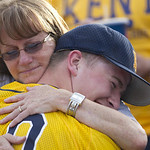 Kent State pitcher Brian Clark gets a hug from his mom Sue after his team's 3-2 win over  Oregon in an NCAA Super Regional to advance to the College World Series.(AP Photo/The Oregonian,  Ro …