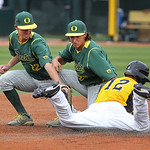 Oregon's J.J. Altobelli, left, and Aaron Payne make a dual tag on basebrunner Alex Miklos, right, after catching him in a rundown during the final game of an NCAA college baseball tournatmen …
